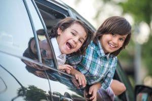 kids smiling in car