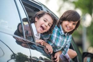 kids smiling in car