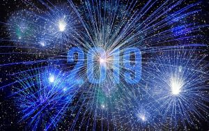 """2019"" written in the sky surrounded by blue fireworks"
