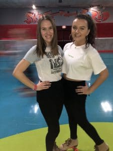 two girls at at a roller skating rink