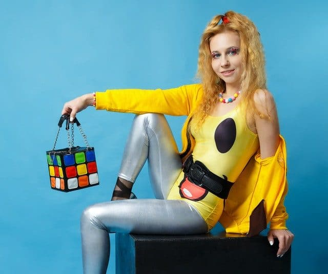 Woman in bright 1980s costume