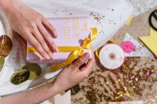 Hands holding wrapped birthday gift